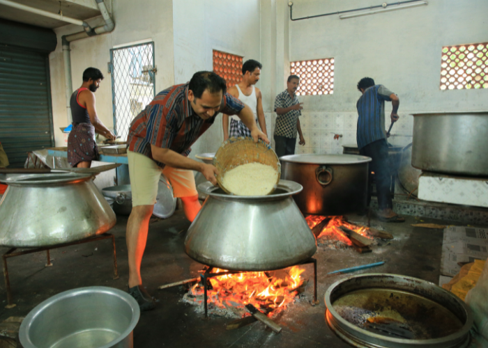 Anand making Biryani on a large scale in the village Chempu, a village in Kerala